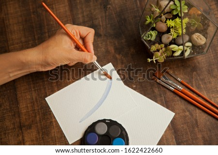 blank sheet on the table with paintbrushes and watercolor #1622422660