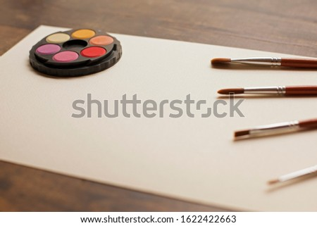 blank sheet on the table with paintbrushes and watercolor #1622422663