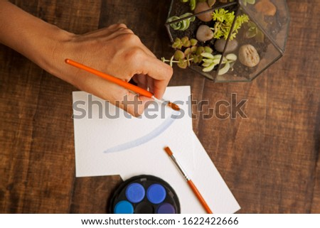 blank sheet on the table with paintbrushes and watercolor #1622422666