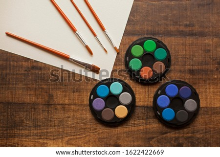 blank sheet on the table with paintbrushes and watercolor #1622422669