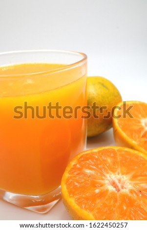 Orange juice with orange (Mandarin Orange)and half of orange isolated on white background. #1622450257