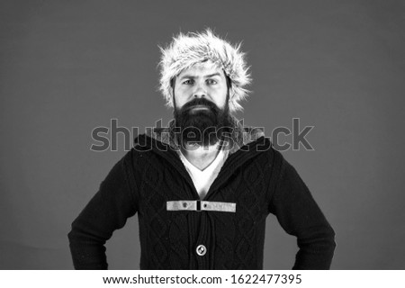 brutal man earflap hat. fur hat accessory. bearded man ready for winter activity. get warm and comfortable. male fashion. serious trendy hipster. beard care in cold season. cold season depression. #1622477395