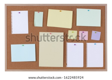 Paper reminder notices on a cork notice board on white background with clipping path #1622485924