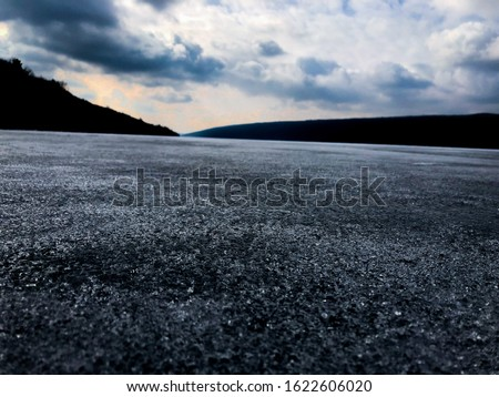 Photo take on Hemlock Lake, NY in late February 2018. Lake was frozen over so took advantage of the ice and walked out to get a better view point.