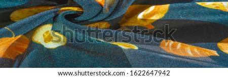 Texture, background, pattern, silk fabric, blue with a print of yellow autumn leaves. #1622647942