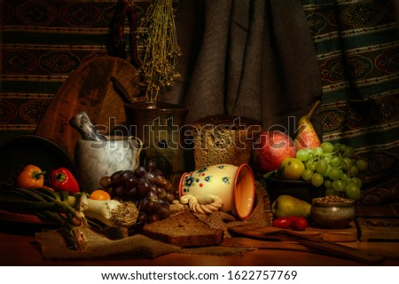 Retro style kitchen still life with fresh vegetable and fruit ingredients, cuts of bread on a wooden table