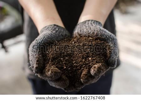 Hand holding organic fertilizer background. Organic fertilizer for organic fruits and vegetables. #1622767408