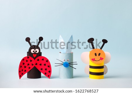 Happy easter spring toy collection on blue background for kids holiday party concept background. Paper crafts, DIY. creative idea from toilet roll. reuse, recycle handmade Royalty-Free Stock Photo #1622768527
