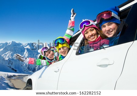 group of friends traveling by car on a vacation to the mountains