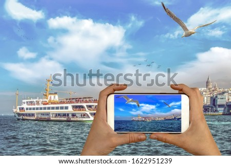 Travel concept - tourist taking photo of Muslim architecture and water transport in Turkey - Beautiful View touristic landmarks from sea voyage on Bosphorus. Cityscape of Istanbul at sunset #1622951239