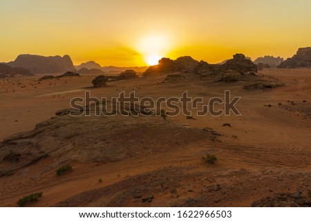 Vintage photos from archive. Jordan. Sunset in Wadi Rum desert. Martian landscapes in lifeless desert. Red rocks and red sand.  #1622966503