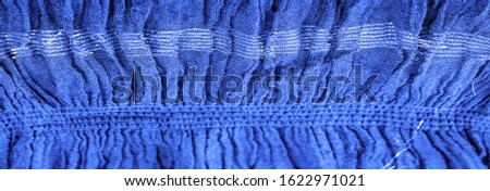 The texture of the background picture, the ornament of the decor, sapphire blue corrugated fabric, fabric with parallel or diagonal folds with serrated folds; products from such a fabric. #1622971021