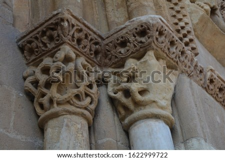 Medieval capitals with different scenes depicted in Romanesque style of the church of San Isidoro, in Leon, Spain. #1622999722