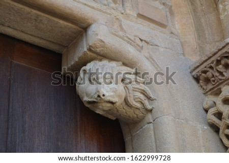 Medieval capitals with different scenes depicted in Romanesque style of the church of San Isidoro, in Leon, Spain. #1622999728