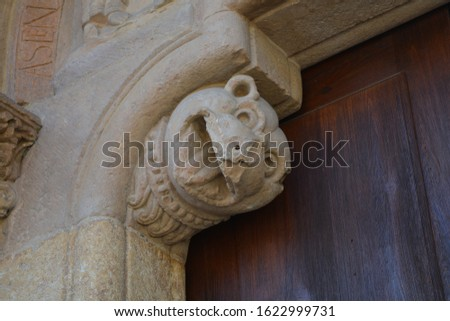 Medieval capitals with different scenes depicted in Romanesque style of the church of San Isidoro, in Leon, Spain. #1622999731