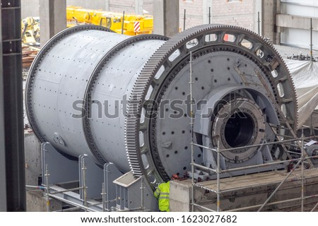 View of the large ball mill or sag mill in the industrial mining plant. Sag mill is an acronym for semi-autogenous grinding. It is also use grinding balls like a ball mill. #1623027682
