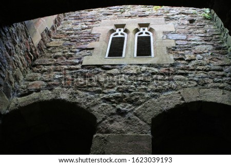 Picture of two windows lokated above an  arch entrance to the Dunster Castle