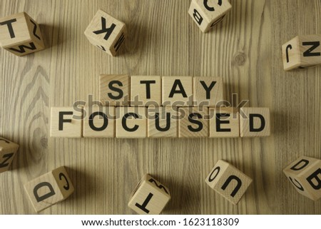 Text stay focused from wooden blocks on desk, business concept #1623118309