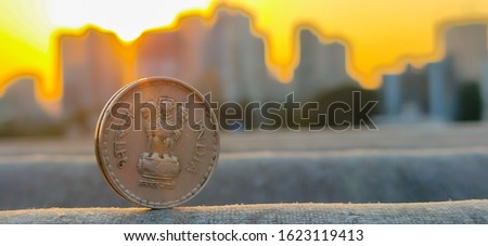 State Emblem of India on Indian Rupees coins with shiny blur background #1623119413
