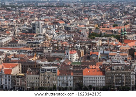 Historical downtown of Budapest, Hungary, Europe from above. Rooftop view with old town buildings, church towers and colorful rooftops. European capital city skyline. #1623142195