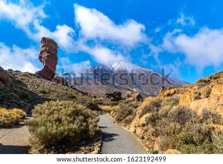 Amazing view of unique Roque Cinchado with famous Pico del Teide in the background on a sunny day, Teide National Park, Tenerife, Canary Islands, Spain. Artistic picture. Beauty world. Travel concept.