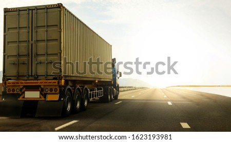 Cargo Truck on highway road with container, transportation concept.,import,export logistic industrial Transporting Land transport on the expressway againt sunrise sky #1623193981