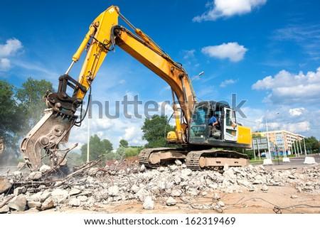 Hydraulic Crusher excavator machine at Site Demolition Royalty-Free Stock Photo #162319469