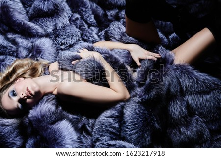 Gorgeous sexy woman lies in expensive silver fox fur coats. Fur coat fashion. Luxurious lifestyle. #1623217918