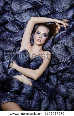 Gorgeous sexy woman lies in expensive silver fox fur coats. Fur coat fashion. Luxurious lifestyle. #1623217930