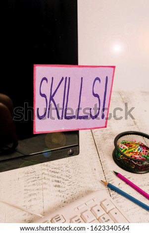 Handwriting text writing Skills. Concept meaning ability do something very well by nature Note paper taped to black computer screen near keyboard and stationary. #1623340564