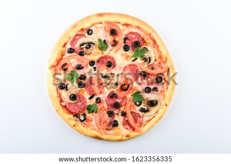 pizza with ham cheese sausage tomatoes and olives on a light background #1623356335