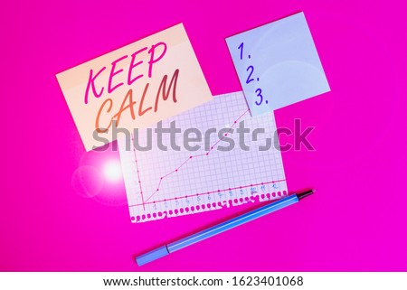 Writing note showing Keep Calm. Business photo showcasing not get emotionally invested in situations you cannot control over Stationary and note paper math sheet with diagram picture on the table.