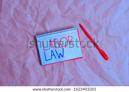 Writing note showing Labor Law. Business photo showcasing rules relating to rights and responsibilities of workers Papercraft desk square spiral notebook office study supplies. #1623403201