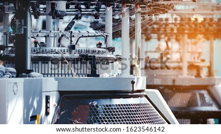 Textile Manufacturing. Circular knitted fabric. Textile factory in spinning production line and a rotating machinery and equipment production company. Clothing industry. Manufacturing textile fabrics. Royalty-Free Stock Photo #1623546142