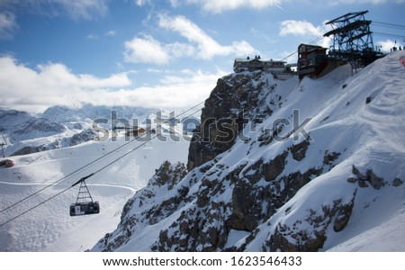 Pic de Saulire courchevel cabin station with gondola view sunset snowy mountain landscape France alpes