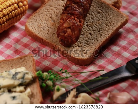 homemade breakfast with homemade sausage, cottage cheese, cooked corn and toast #1623576820