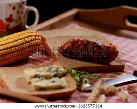 homemade breakfast with homemade sausage, cottage cheese, cooked corn and toast #1623577114