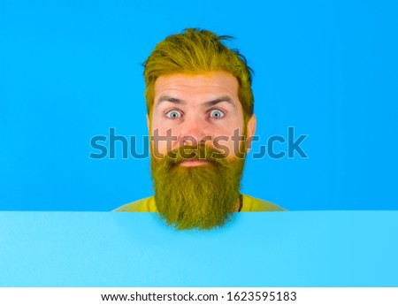 Close up portrait of bearded man holds advertising board. Seasons sale. Discount. Black friday. Advertising and sale. Online shopping. Advertising banner. Copy space. Barber fashion. Beauty marketing.