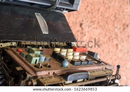 Old and damaged mechanical calculating machine #1623669853