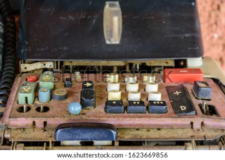 Old, dirty and damaged mechanical calculating machine #1623669856