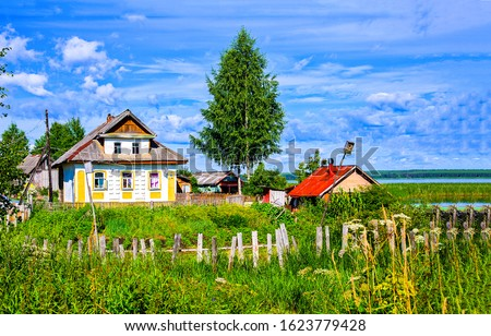 Summer village farm house view. Russian village scene. Village in Russia #1623779428