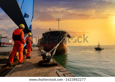 mooring man in charge of safety sailing of the ship leaving from the port Royalty-Free Stock Photo #1623882277