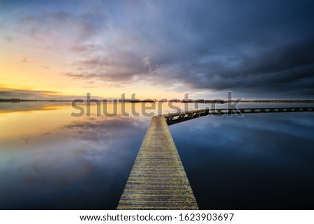 A peaceful and relaxing evening at the lake with a beautiful sunset - a tranquil image #1623903697