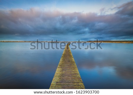 A peaceful and relaxing evening at the lake with a beautiful sunset - a tranquil image #1623903700