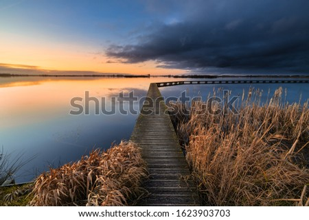 A peaceful and relaxing evening at the lake with a beautiful sunset - a tranquil image #1623903703