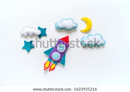 Rocket craft space toy. Made from felt. Material for children's creativity.