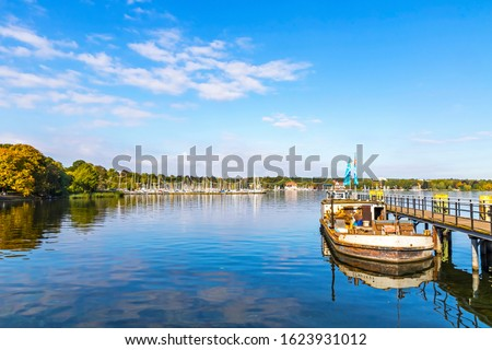 Boat piers on Wannsee lake in Berlin, Germany. Wannsee (or Grosser Wannsee) is a bight of the Havel river near the locality of Wannsee and Nikolassee in the borough of Steglitz-Zehlendorf in Berlin Royalty-Free Stock Photo #1623931012