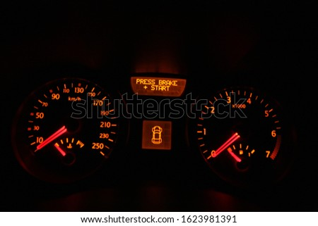 Car dashboard showing the instrument panel with board computer and the basic gauges: water, fuel, speed and tachometer #1623981391
