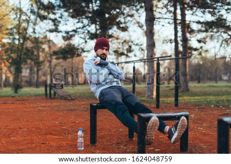 handsome young man jogging outdoors in city park work out in outdoor gym #1624048759