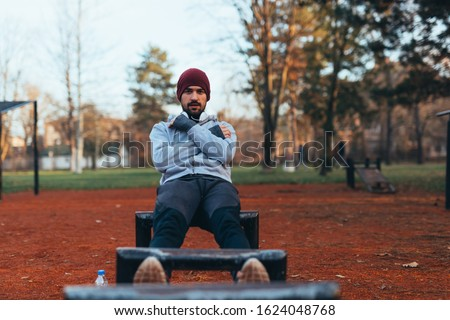handsome young man jogging outdoors in city park work out in outdoor gym #1624048768